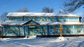 stock photo of deacon  - The image of long rural church in winter - JPG