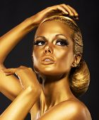 Reflexion. Portrait Of Glossy Woman With Bright Golden Makeup. Bronze Bodypaint