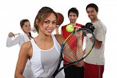 stock photo of ball cap  - Teenagers dressed for different sports - JPG