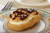 foto of eclairs  - Cream filled eclair with chocolate on top - JPG