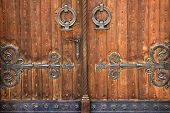 foto of shackles  - The old wooden massive door with shackles - JPG