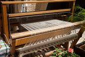 stock photo of thread-making  - Hand loom in front view  - JPG