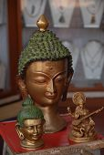stock photo of siddhartha  - Lord Buddha made of copper or bronze also has Hindu God besides - JPG