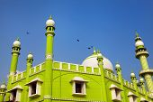 stock photo of mosk  - Green Mosque at blue sky in Kovalam Kerala India - JPG