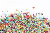 stock photo of sprinkling  - Colorful sugar sprinkles on a white background - JPG