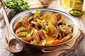 stock photo of saucepan  - venus clams in tomato sauce - JPG
