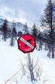 pic of avalanche  - An avalanche warning sign at Lake Louis Ski Resort in Alberta Canada - JPG