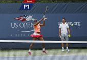 Grand Slam champion Serena Williams practices for US Open 2013 with her coach Patrick Mouratoglou