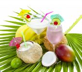 stock photo of loco  - Tropical cocktail with coconut milk served on palm leaf - JPG