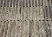 stock photo of asbestos  - Old worn asbestos roof on small shelter - JPG