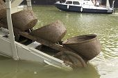 picture of dredge  - scoops at the end of a dredge boat - JPG