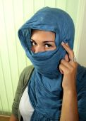 Muslim Girl with covered face and hair.