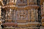 stock photo of khajuraho  - Erotic depiction of a sexual act on a temple wall in Khajuraho - JPG