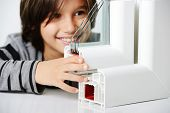 foto of hermetic  - Kid holding plastic window profile - JPG