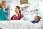 foto of intensive care unit  - Mother And Daughter With Nurse In Intensive Care Unit - JPG