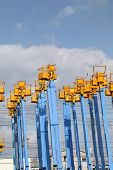 stock photo of cherry-picker  - Cherry picker platform against a sky with clouds - JPG