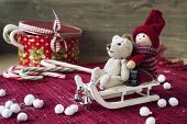 Christmas Decor - Miniature Toys On Sledges. Gift Box With Candies.