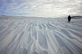 image of chukotka  - Single traveler goes on snow - JPG