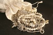picture of pompous  - bag spilled over with jewels falling out - JPG