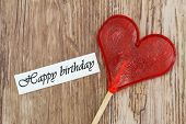 stock photo of lollipops  - Happy Birthday card with heart shaped lollipop - JPG
