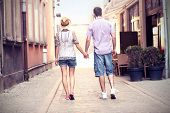 foto of stroll  - A picture of the back of a young couple strolling about the city - JPG