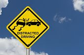 pic of driving  - No Distracted Driving Sign Yellow warning sign with words Distracted Driving and accident icon with sky background - JPG