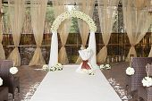 foto of wedding arch  - Beautiful wedding arch with white roses in the restaurant - JPG