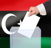 stock photo of libya  - electoral vote by ballot under the Libya flag - JPG