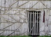 stock photo of longhouse  - Front door of a historical Native American Longhouse - JPG