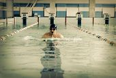 stock photo of swim meet  - Professional male swimmer swimming in the pool - JPG