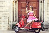 pic of scooter  - Young and sexy woman with her motor scooter and a vintage photo camera  - JPG