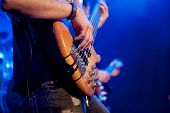 stock photo of guitarists  - Boy hands touching the strings of a bass - JPG