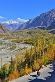 stock photo of karakoram  - unidentified men riding the motorcycle in Ghizer Valley - JPG