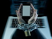 pic of addict  - Hands of caucasian businessman addicted to mobile phone bond and locked with iron chain wrists in smartphone internet addiction and slave to online network addict concept - JPG