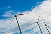 stock photo of wind-farm  - Row of wind turbines on a wind farm generating - JPG