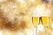 stock photo of special occasion  - Glasses with champagne against fireworks and sparkling holiday background - JPG