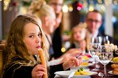 image of wieners  - Family celebrating Christmas eve with traditional dinner Wiener sausages and potato salad  - JPG