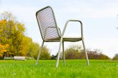 foto of lawn chair  - metal chair on a green lawn - JPG