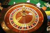 pic of roulette table  - Roulette wheel with green gaming table in the casino - JPG