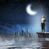 pic of boys night out  - Young boy at night with fishing rod - JPG