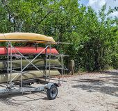 stock photo of trailer park  - Four kayaks in a trailer ready for trip - JPG