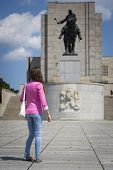 picture of v-day  - Girl on a walk at the memorial statue of Jan Zizka a national cultural monument of the Czech Republic in V - JPG