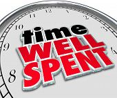 picture of saying  - Time Well Spent words on a clock face as a saying or quote illustrating a good investment of effort and resources with positive roi or return on investment - JPG