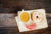 foto of donut  - Donuts and coffee on a dark wood background - JPG