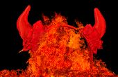 pic of sinful  - Devil party horns in fire flames temptation or sin concept - JPG