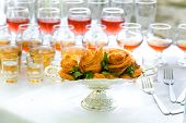 stock photo of eclairs  - eclairs and drinks on a banquet table - JPG