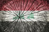 foto of euphrat  - flag of Iraq on cracked wooden texture - JPG
