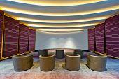 image of cinema auditorium  - Auditorium a small cinema room brightly lit - JPG