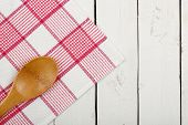 pic of ladle  - napkin and wooden ladle on white planks - JPG