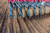 foto of plowing  - Sowing and plowing action in the spring season - JPG